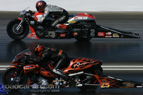 Vance and Hines competes with Guidera while wearing his Vanson Leathers drag racing suit